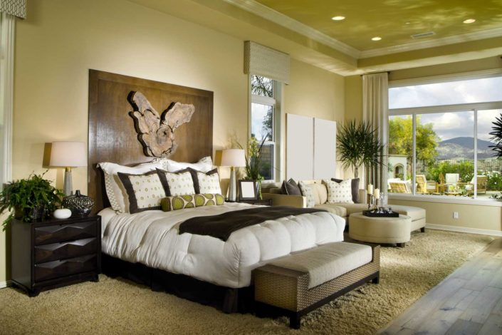 Beautiful bedroom with large wood artwork over bed.