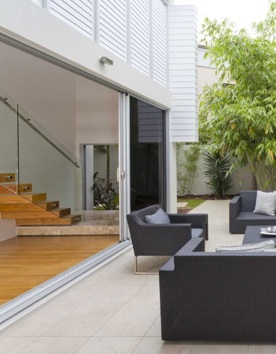 Modern condo courtyard patio with outdoor furniture.