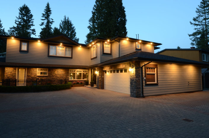Renovated home with rock and wood siding. shot taken at dusk.