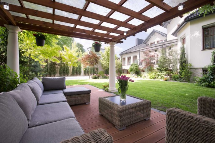 Outdoor gazebo with large couch in new custom home.