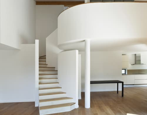 Staircase up to second level curved loft.