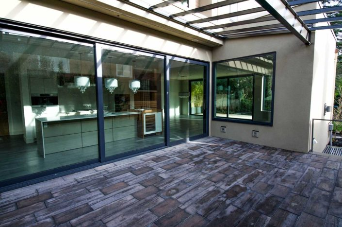 Modern West Vancouver home pictured from the new slate patio.
